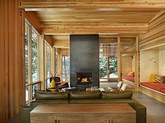 built in extra bed, reading nich, extra seating for living area at ski house--also like fireplace that allows you to see the porch beyond. probably have radiant heat floors too. North Lake Wenatchee Cabin by DeForest Architects