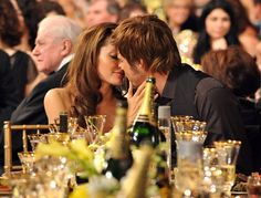 Pin for Later: Look Back at Brad and Angelina's Sexiest PDA Moments  Angelina planted a kiss on Brad during the SAG Awards in January 2008.