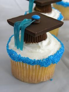 Graduation Cupcakes: peanut butter cups, chocolate squares, mini M & M s, fruit roll-up or Twizzlers pull n peel, or other similar tassel-making candy.  Oh yeah, and a frosted cupcake.