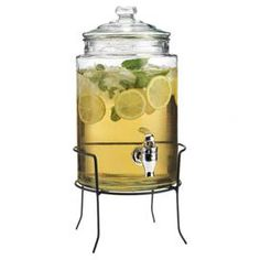 "Glass beverage dispenser in a stand.             Product: Beverage  dispenser and stand     Construction Material: Glass and metal     Color: Clear and black      Features: 1.5 Gallon capacity   Dimensions: 17"" H x 8.25"" Diameter       Note: For cold beverages only    Cleaning and Care: Hand wash"