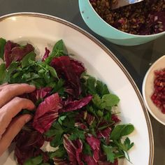 Assembling tonight's salad of Beetroot lentils Freekeh on a bed of parsley mint and radicchio. Plus pomegranate seeds and pom molasses in the dressing. It's purple on purple on purple. I felt like Ottolenghi with the prep in this one. But it was just stunning. And teamed nicely with the lamb.