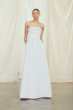 Fold over strapless bodice with dirndle skirt in faille. Pockets in skirt. Fully lined Pockets in skirt Back zip with hook-and-eye closure Professionally dry clean per label instructions Imported Shown in Platinum Amsale Bridesmaid, Bridesmaid Dresses, Wedding Dresses, Bridesmaids, Dirndl Skirt, Stunning Dresses, Bridal Boutique, Bridal Collection, Bridal Gowns