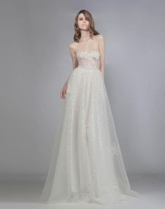 Fall 2016 Victoria KyriaKides strapless wedding dress with swiss dot tulle skirt | https://www.theknot.com/content/victoria-kyriakides-wedding-dresses-bridal-fashion-week-fall-2016