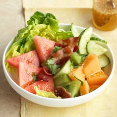 Melon Salad with Sweet Sesame Dressing - The sweetness of the watermelon, cantaloupe, and honeydew in this delicious salad recipe tempers the spice of the cayenne pepper in the dressing.