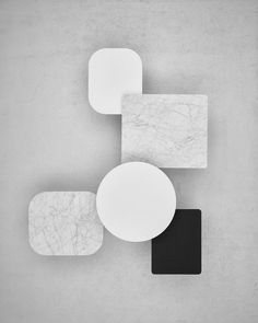 Marble coffee tables by Jens Fager. Minimal design in black white and marble. I want one of these tables in my living room.