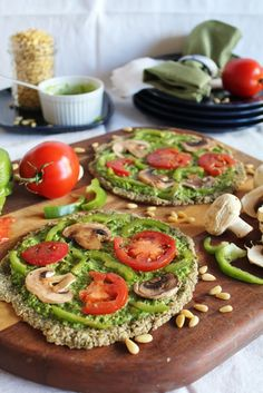 Vegan, raw pizza with spinach pesto & marinated vegetables