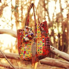 Gorgeous photo of RR Sutara bag  Love it adorned with that beautiful feather necklace from @wildandfreejewelry
