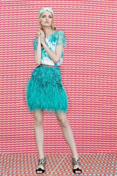 """This feathery skirt reminds of my time in Rio de Janeiro. Just like the city, it is vibrant and fun. It has a naughty, carnival vibe as well as sleek tailoring to show off your frame. I might wear it dressed down with a simple white tee or with an oversized fur jacket for more glamour."" Katie Readman chooses her Matthew Williamson favourite from Pre Spring 2015."