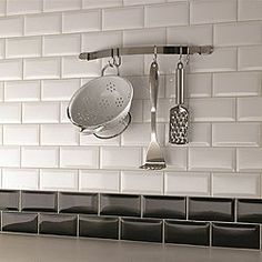 Love the idea of a border of tiles matching the worktop at the base of a splashback - Underground tiles from B&Q