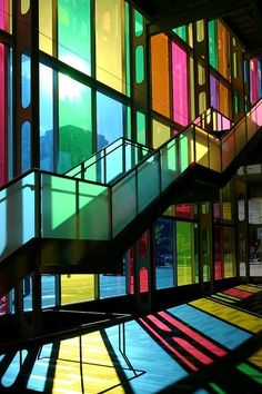 """Colorful stained glass window staircase in the """"Palais Des Congres Montreal Canada"""" photographed by Pierre Leclerc Montreal Ville, Montreal Quebec, Belle Villa, Mondrian, Staircase Design, Bauhaus, Stairways, Colored Glass, Interior Architecture"""