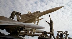Iranian soldiers prepare to launch a Hawk surface-to-air missile during military maneuvers at an undisclosed location