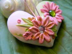 Marbled moss green and soft pink heart sculpted with delicate flower petals, buds and leaves measures 1.5 x 2 inches.  A little Love for the Summer!