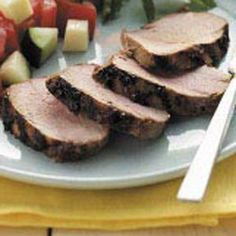 """Easy Grilled Pork Tenderloin Recipe -""""We've been making this dish for years and everyone who tastes it requests the recipe,"""" writes Debbie Wigle of Williamson, New York. """"We often double it and serve the leftovers on a mixed green salad."""""""