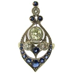 Belle Epoque Sapphire and Diamond Ring Sapphires and Old Mine Cut Diamonds set in Platinum European Circa 1910