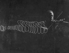 """arpeggia: """" Violinist Jascha Heifetz playing in Mili's darkened studio as light attached to his bow traces the bow movement. Photo by Gjon Mili, 1952 - LIFE archive More posts """" Gjon Mili, Jean Shrimpton, Miguel Angel, Francisco Javier Rodriguez, Jascha Heifetz, Light Painting Photography, Sequence Photography, Movement Photography, Bw Photography"""