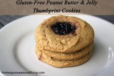 Gluten-Free Peanut Butter & Jelly Thumbprint Cookies made with honey and coconut flour.