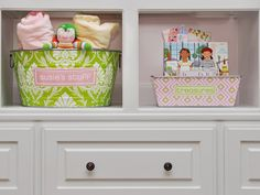 """Containers this cute will see a young girl through tweendom and into college. Designer Susie Fougerousse says: """"Boxes and bins are great for corralling kid stuff because they can be stored on bookshelves, under beds or simply on the floor for easy access. Children can even tote them around the house from room to room."""""""