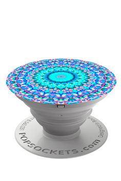 Popsockets Arabesque design is a blue mandala pattern. PopSockets not only make terrific phone grips and phone stands they also make holding tablets and e-readers more comfortable and secure. While PopSockets do not stick to all devices and cases -- especially those made of silicone or with a waterproofing coating -- they do stick to most typical devices and cases. And with the PopClip companion product they mount to nearly any vertical surface including dashboards mirrors bed posts…