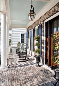 This beautiful porch in Charleston was constructed from the same bricks that are on the walls of the home (Boral Shadow Stone with Savannah ivory mortar). The traditional beadboard ceiling is covered in Duron Paint's Piazza Blue.