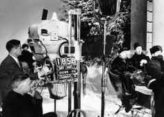 "Cameraman WILLIAM DANIELS and director Clarence Brown shooting Greta Garbo and Basil Rathbone in a sleigh scene for ""Anna Karenina"" (1935)."