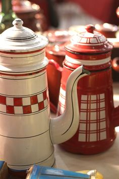 red+white enamel ware coffee pots!! from 1930s. After the great depression every thing was made red and white so folks would start to feel better!!