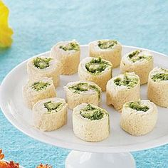 Make quick and easy appetizer pinwheels with sandwich bread, cream cheese and prepared pesto.