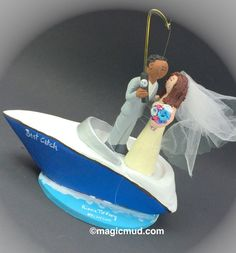 Yachting Wedding Cake Topper, Boating Wedding Cake Topper, Interracial Wedding Cake Topper,    This photographed listing is but an example of what we will create for you....simply email or call toll free with your own info and pictures of yourselves, and we will sculpt for you a treasured memory from your wedding! $235 #magicmud 1 800 231 9814 www.magicmud.com