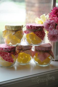 Simple party favors: Old-fashioned lemon drop candies in recycled jars.