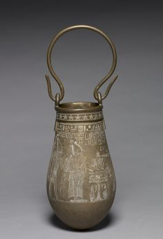 Decorated Situla, 305-30 BC Egypt, Ptolemaic Dynasty bronze, Diameter - w:15.50 cm (w:6 1/16 inches) Diameter of mouth - w:10.20 cm (w:4 inches) Overall - h:28.30 cm (h:11 1/8 inches) with handle - h:45.20 cm (h:17 3/4 inches). Cleveland Museum of Art