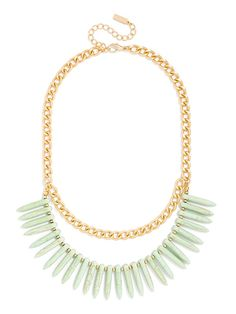 A strand of organic quills is edged up with a contrasting gold curb chain for a modern tribal essential.