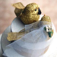 glittery gold love birds wedding cake topper from beckykazana