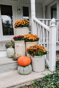 Cozy Rustic Fall porch - Mums in crocks to give a farmhouse porch an instant fall vibe. Great source for farmhouse decor. by roslyn