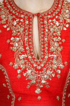 Red and peach Lehenga Choli full sleeves blouse in dupion base appliqued with floral gold and silver sequins embellishment, dori and dabka embroidery on the front and back neckline and sleeves. It has flower embroidered motifs scattered all over. Embroidery Suits Punjabi, Zardozi Embroidery, Embroidery On Kurtis, Kurti Embroidery Design, Embroidery Neck Designs, Hand Work Embroidery, Embroidery Dress, Beaded Embroidery, Anarkali