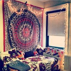 tapestry and string lights --> love the placement of the bed next to the window