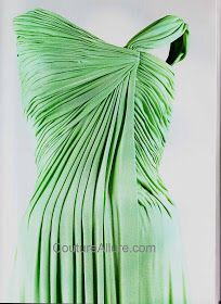 Jackie had just returned from a vacation in Palm Beach and was deeply tanned. She was luminous in green draped silk jersey by Oleg Cassini.