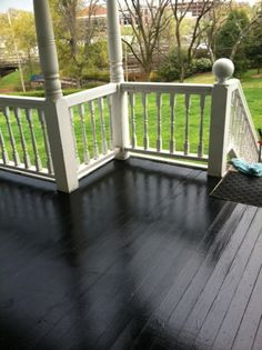 glossy black porch floor---rails are already this color This is my next job to do in the next couple of weeks.