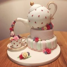Pouring teapot cake with fondant teacup