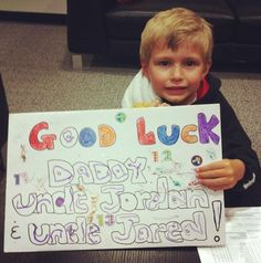 "aww Parker Staal at tonights game. the back of his sign says ""No One Likes Uncle Marc"""