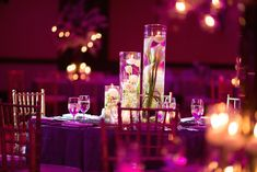 The reception table's centerpiece was composed of ivory calla lilies and tulips submerged in three cylindrical vases of varying heights. #centerpiece Photography: VIVIDA. Read More: http://www.insideweddings.com/weddings/colorful-destination-indian-wedding-in-playa-del-carmen-mexico/646/