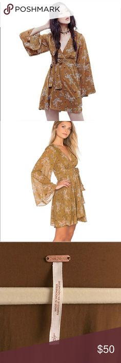 Free People Bell Sleeve Kimono Gypsy Dress Lightweight, deep v neck, hides tummy and arm areas, light floral print. Compliments brunette hair and darker skin tones. perfect for summer events! Free People Dresses Mini