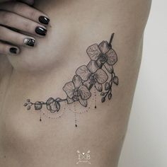 Orchids tattoo by Irene Bogachuk