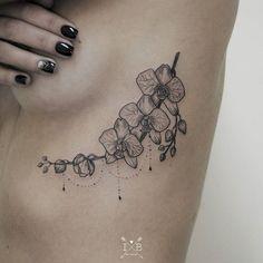 Orchids tattoo by Irene Bogachuk #IB_TATTOOING #tattoo #dotwork #botanicaltattoo #orchids #orchidstattoo #branchtattoo #ribstattoo #girlytattoo #ink #inked #inkspiration
