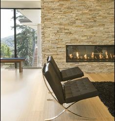 Lovely Rectangular fireplace with a contemporary twist/ by Mark English Architects