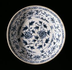 Dish with Lotus Sprays, Floral Scrolls, and Lotus Petals, Vietnam, 1450-1550. Wheel-thrown stoneware with cream slip, underglaze blue painted decoration, and clear glaze. Height: 2 7/16 in. (6.19 cm); Diameter: 11 1/8 in. (28.26 cm). Los Angeles County Museum of Art, Gift of Ambassador and Mrs. Edward E. Masters (M.84.213.254). Photo © Museum Associates/LACMA