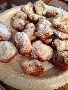 Easiest doughnuts ever!! Roll of buttermilk biscuits, cut in pieces and fried. Top with powdered sugar or melted chocolate and sprinkles