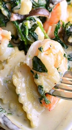 Ravioli with Seafood, Spinach & Mushrooms in Garlic Cream Sauce 4 from willcookforsmiles...