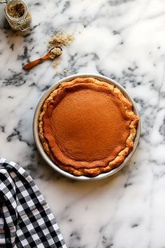 "The 6 Best Pie Recipes EVER  #refinery29  http://www.refinery29.com/2014/01/61048/best-pie-recipes#slide-1  The Foodie: Joy from Joy The BakerThe Perfect Pie: Salty Honey Pie ""My favorite pie these days is this Salty Honey Pie from the Four and Twenty Blackbirds Pie Book. It's a perfectly sweet custard with depth from honey and cream, highlighted by the occasional salty bite. The balance is divine!""IngredientsFor the Crust: 1/2 cup (4 oz) cold unsalted butter, cut into small cubes  1 1/2 cup all-purpose flour  2 tsp granulated sugar  1/2 tsp salt  1/3 cup cold buttermilkFor the Filling:  1/2 cup (1 stick) unsalted butter, melted  1/2 cup granulated sugar  1 tbsp white cornmeal  Scant 1/2 tsp salt  1 vanilla bean, split and scraped (or 2 tsp pure vanilla extract)  3/4 cup honey (I use raw sage honey)  3 large eggs  1/2 cup heavy cream  2 tsp apple cider vinegar  1-2 tsp flaked sea salt (I used Vanilla Sea Salt)Directions To make the crust, in a medium bowl, whisk together flour, sugar, and salt.  Add cold, cubed butter and, using your fingers (or a potato masher), work the butter into the flour mixture. Quickly break the butter down into the flour mixture; some butter pieces will be the size of oat flakes; some will be the size of peas. Create a well in the mixture and pour in the cold buttermilk.  Use a fork to bring the dough together. Try to moisten all of the flour bits. Add a bit more buttermilk if necessary, but you want the mixture to be shaggy and not outwardly wet.  On a lightly floured work surface, dump out the dough mixture. It will be moist and shaggy. That's perfect. Gently knead into a disk. Wrap the disk in plastic wrap and refrigerate for one hour. Allowing the dough to rest in the refrigerator will help rechill the butter and distribute the moisture.  To roll out the pie crust, on a well-floured surface, roll the crust 1/8-inch thick and about 12 inches in diameter. Transfer it to a pie pan. Trim the edge almost even with the edge of the pan. Fold the edges under and crimp with your fingers or a fork. Cover it with plastic wrap and refrigerate it for a minimum of 30 minutes and a maximum of three hours.  Preheat the oven to 375 degrees. Place a rack in the center of the oven.  To make the filling, in a medium bowl whisk together melted butter, sugar, cornmeal, and salt. Split vanilla bean and add the vanilla bean scrapings (or extract, if using) into the butter mixture and whisk until thoroughly combined. Whisk in honey.  Add the eggs, one at a time, whisking to combine.  Whisk in heavy cream and vinegar.  Pour the filling into the prepared pie crust. Bake pie for 45 to 55 minutes until pie is deep golden brown and puffed around the edges and set in the center. Open the oven and rotate the pie halfway through baking. Remove from the oven and allow to rest for at least four hours before serving. Serve warm or at room temperature, and sprinkle with sea salt just before serving."