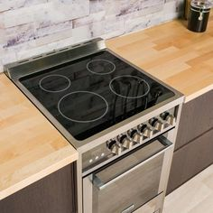 Magic Chef Freestanding Electric Range in Stainless Steel/Black Image 4 of 5 Small Oven Stove, Small Electric Stove, Stove Top Oven, Electric Cooktop, Kitchen Stove, Kitchen Appliances, Tiny House Appliances, Convection Cooking, Microwave Convection