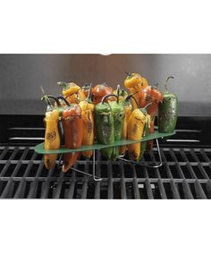 Featuring a stainless steel construction for efficient and even heating, this grilling rack can hold up to 22 peppers at a time, perfect for entertaining.