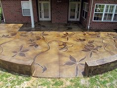 An acid stained concrete patio. The vines were inspired by the client's interest in leaf paintings. Artisan: Rick Lobdell, Concrete Mystique.